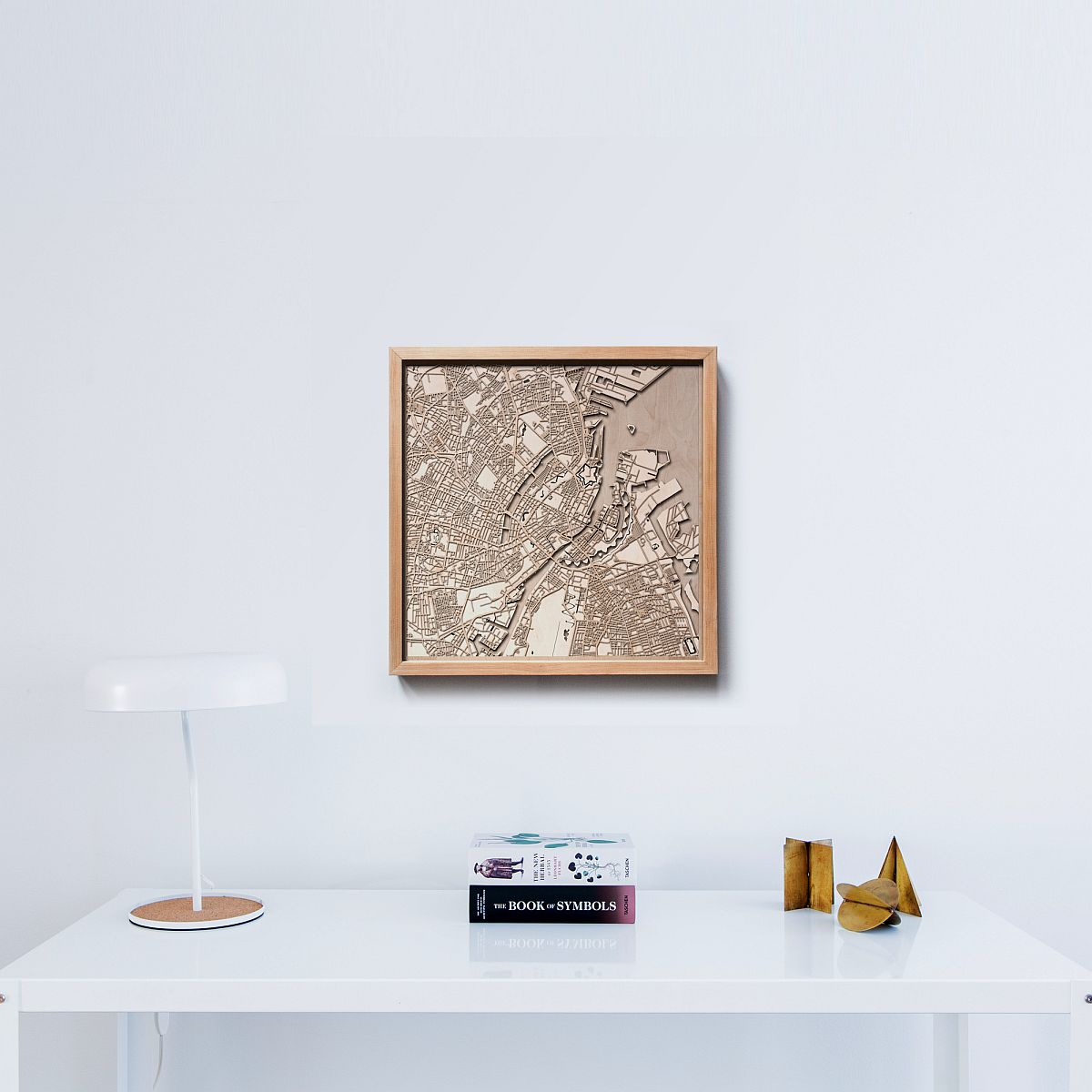 Turn the framed 3D maps in wood into the focal point of the office space