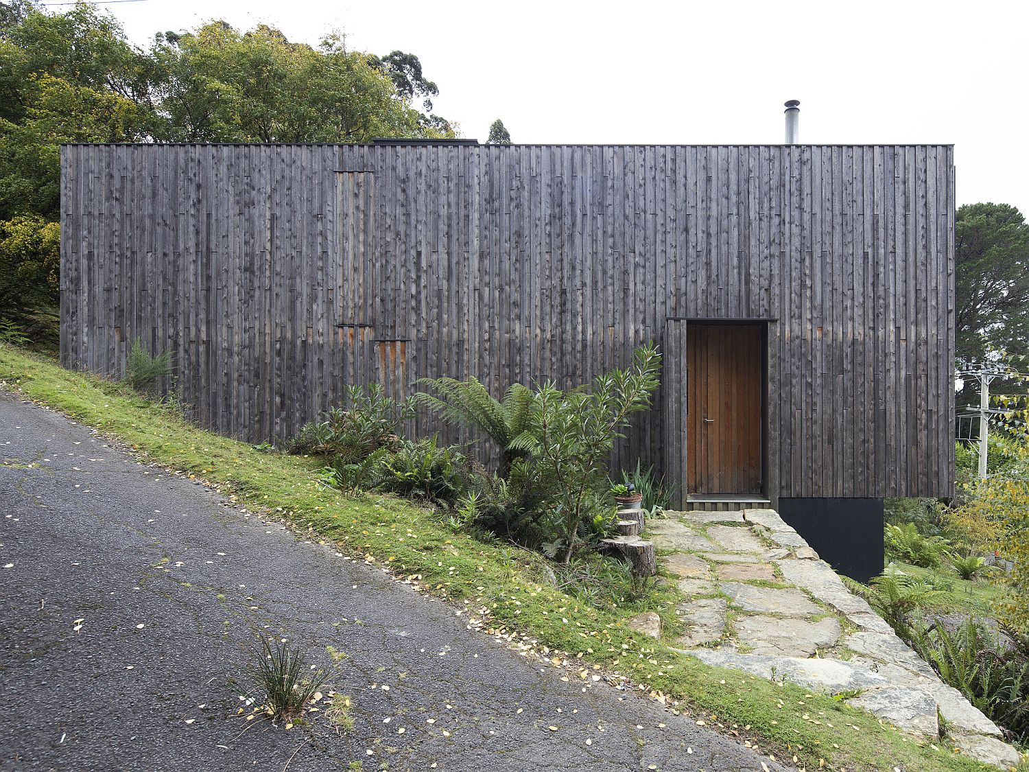 Unfinished timber face of the house gives it a vernacular appeal