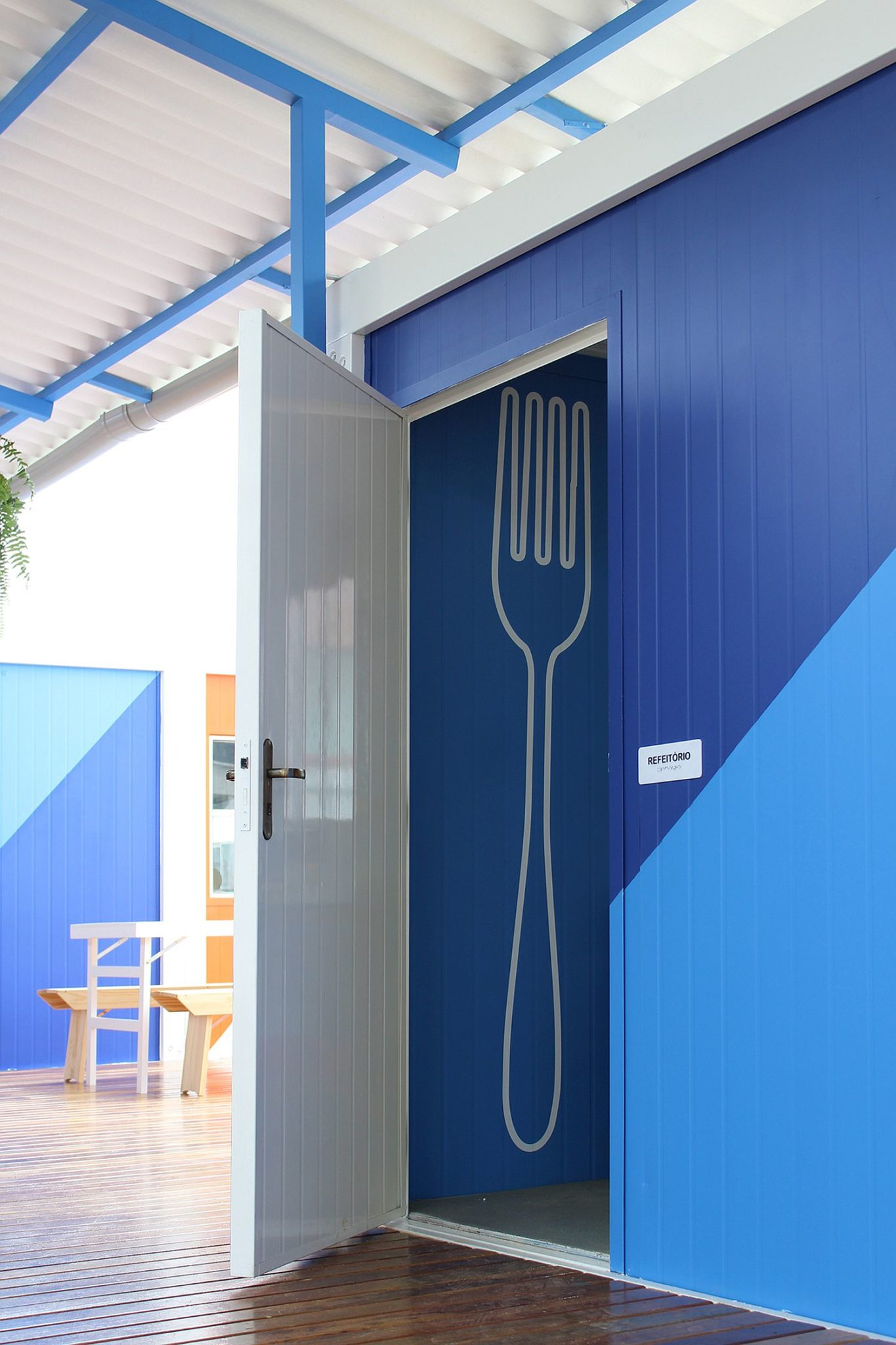 Walls in blue and white inside the JAMDS Social Center