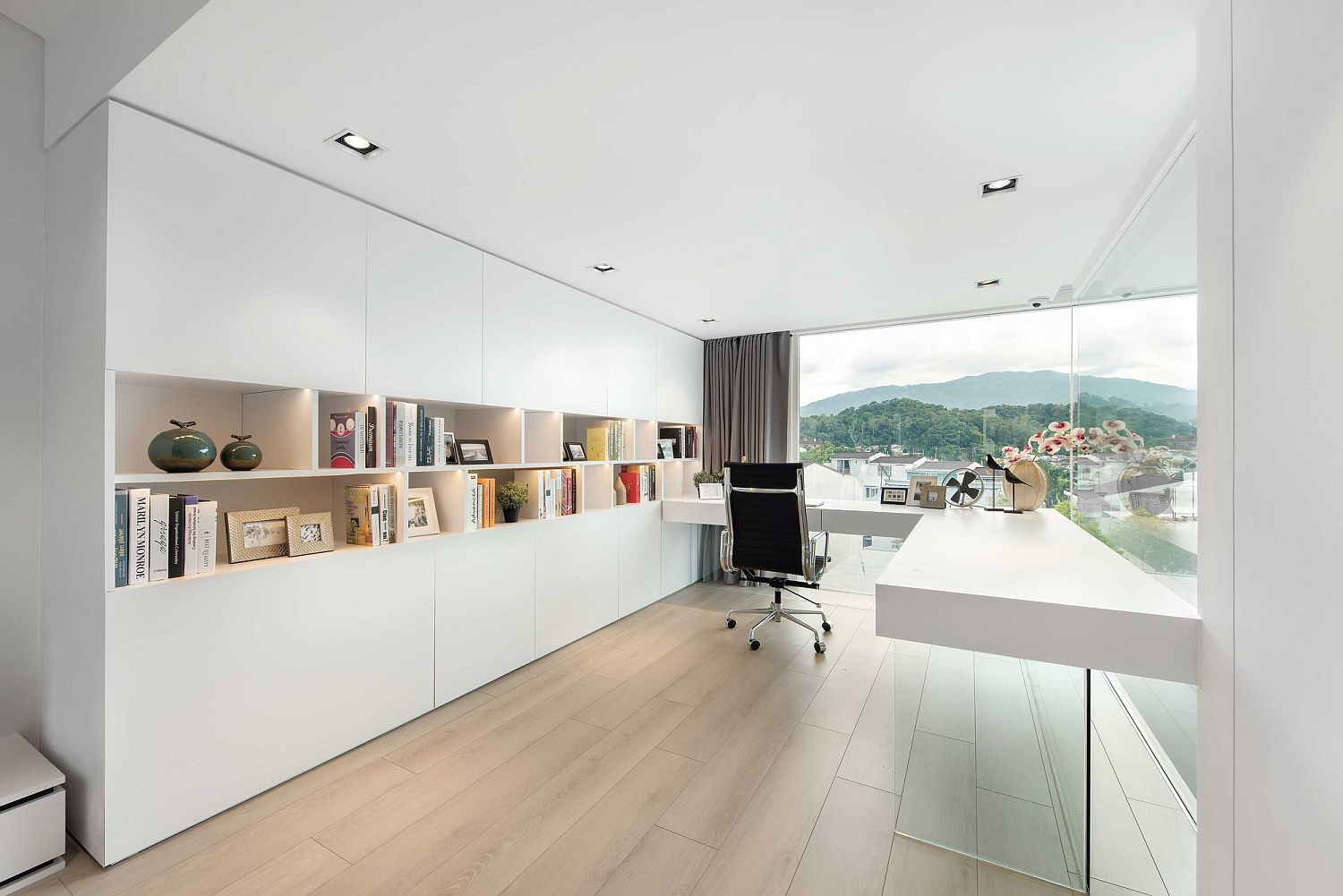 White-and-refined-home-office-with-ample-shelving-and-storage-space
