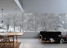 White-dining-space-of-the-house-with-a-view-of-the-snow-clad-landscape-outside-217x155