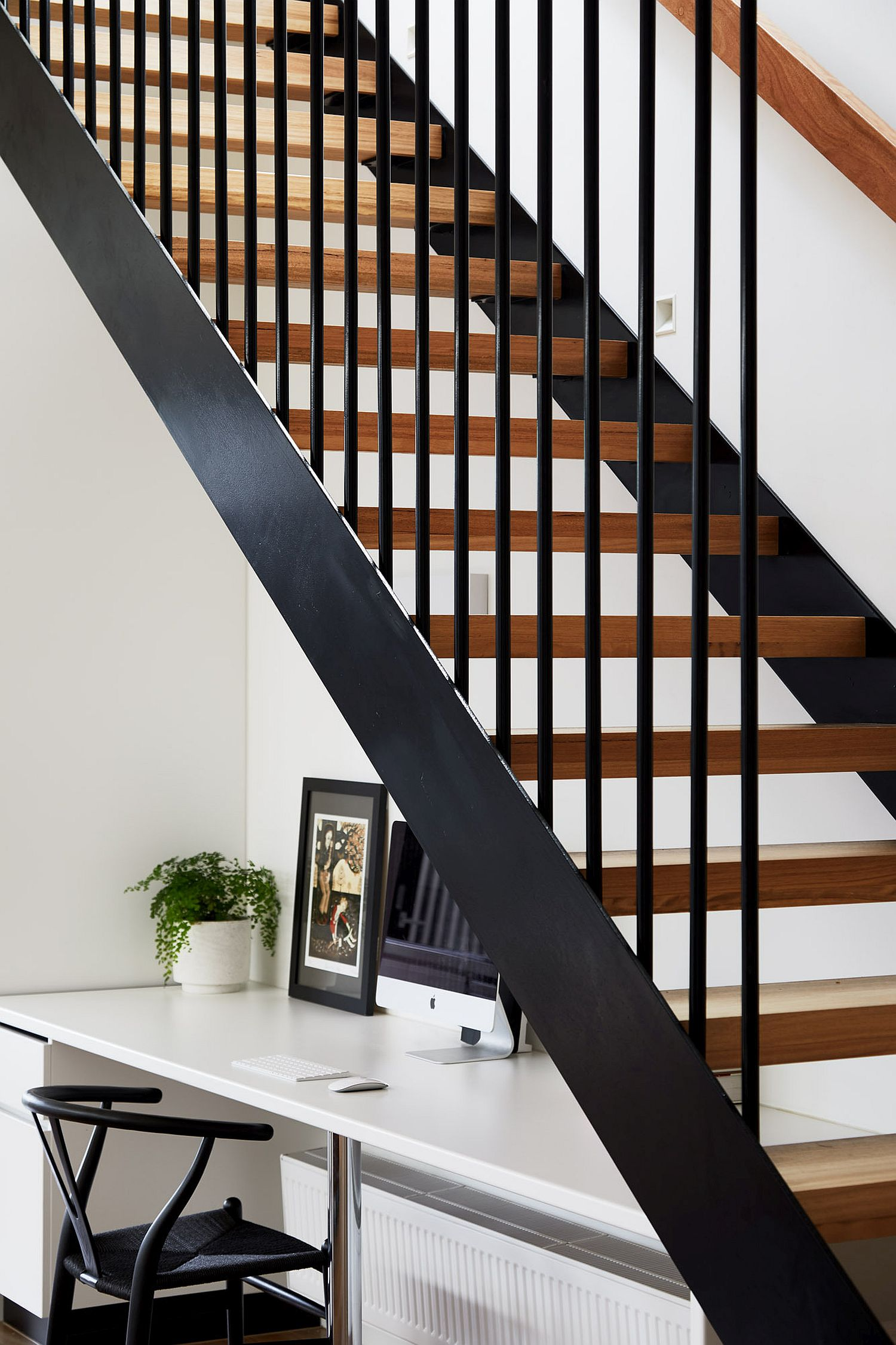 Wood and metal staircase inside the modern Edwardian house