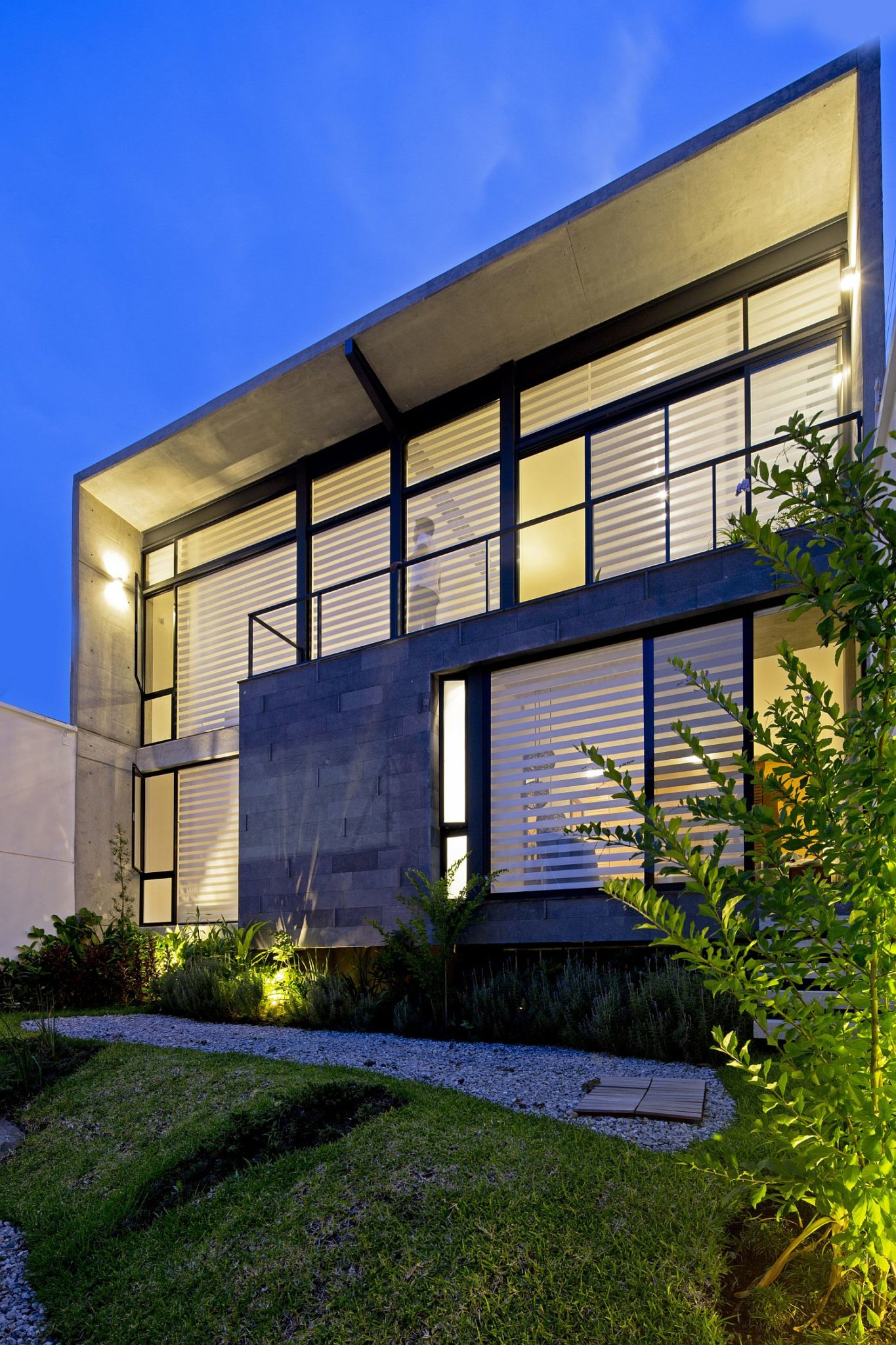 Wood stone, glass and concrete give the home a unique facade