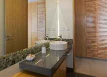 Wooden-floating-vanity-inside-the-contemporary-bathroom-with-stone-countertop-217x155