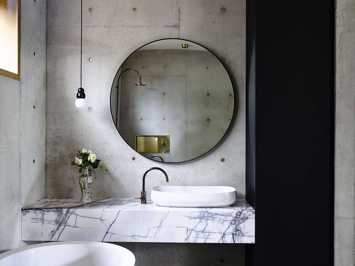 Bathroom with concrete wall and marble vanity