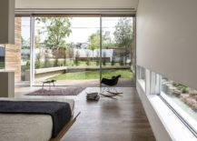 Beautiful-bedroom-connected-with-the-expansive-garden-using-sliding-glass-doors-217x155