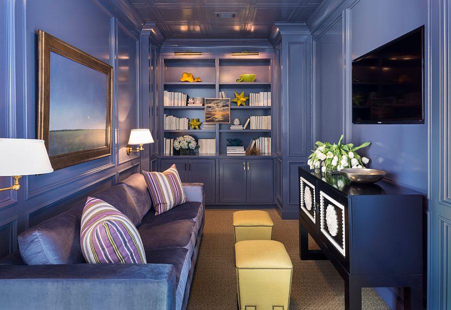 Beautiful monochromatic TV room in dark blue