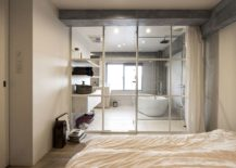 Bedroom-and-bathroom-separated-using-framed-glass-wall-217x155