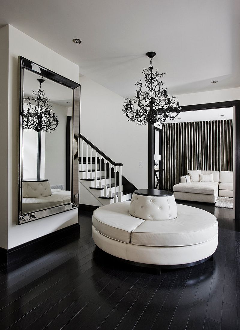 Black and white contemporary entry with a giant mirror