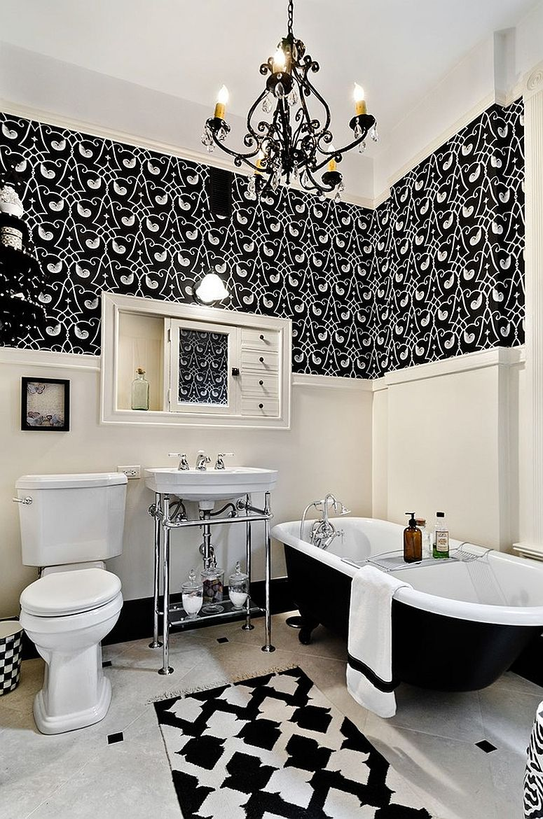 Black and white modern bathroom with a bathtub and chandelier in black