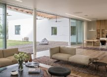Bright-and-cheerful-modern-living-room-connected-with-the-pergola-covered-deck-217x155