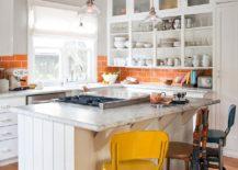 Cheerful-modern-kitchen-in-white-with-a-smart-tiled-orange-backsplash-217x155