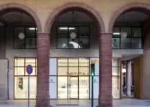 Classic-arches-of-the-building-stand-in-contrast-to-the-minimal-store-front-217x155