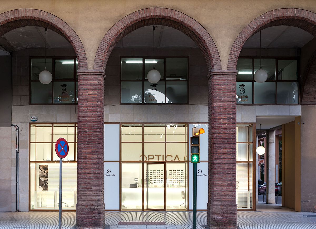 Classic arches of the building stand in contrast to the minimal store front