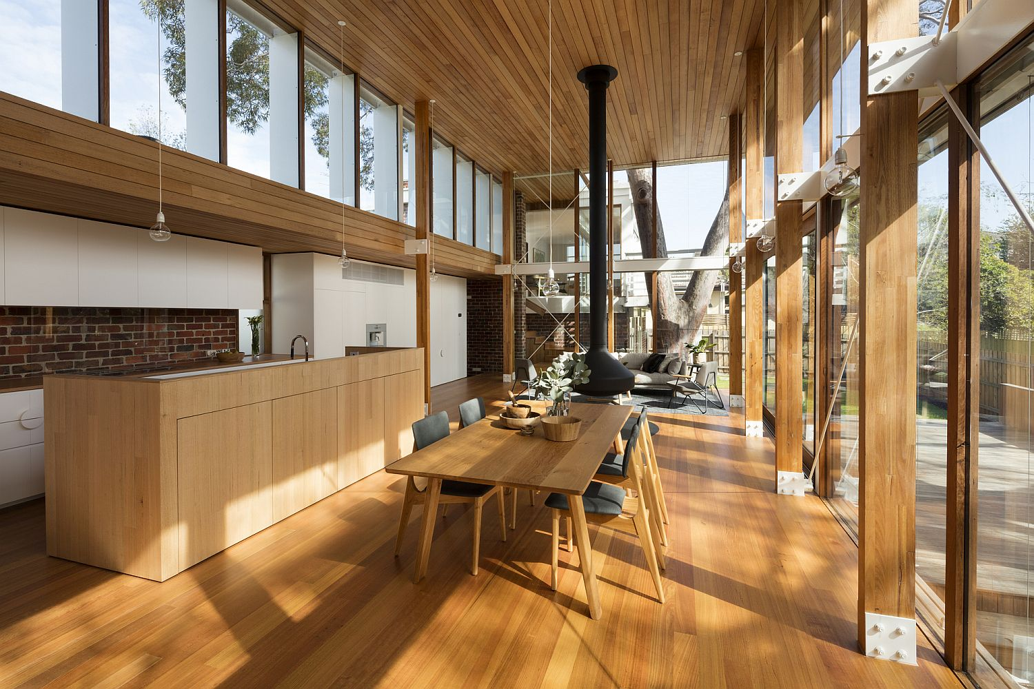 Beautiful brick walls and sweeping spaces suburban home for Natural light in homes