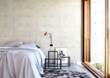 Contemporary-bedroom-with-concrete-and-glass-walls-217x155