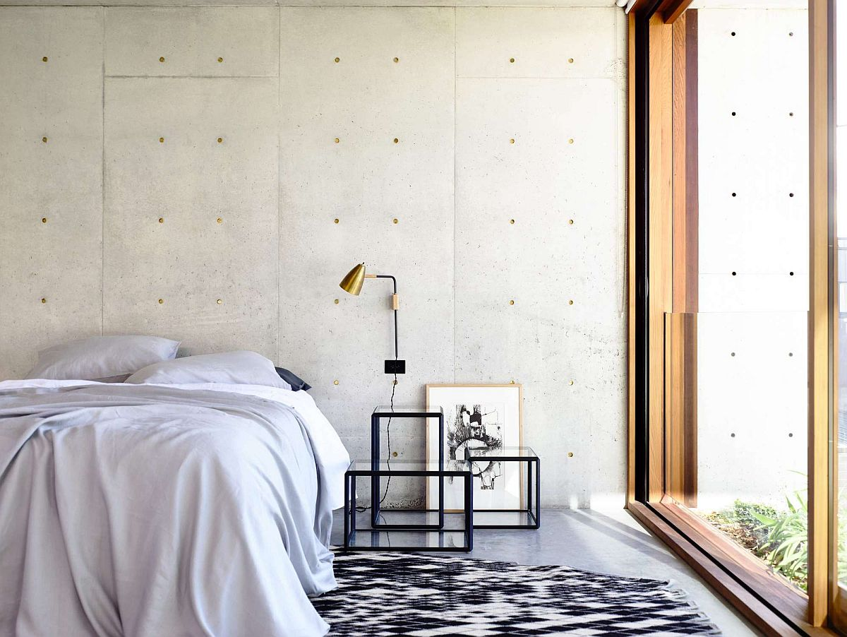 Contemporary bedroom with concrete and glass walls