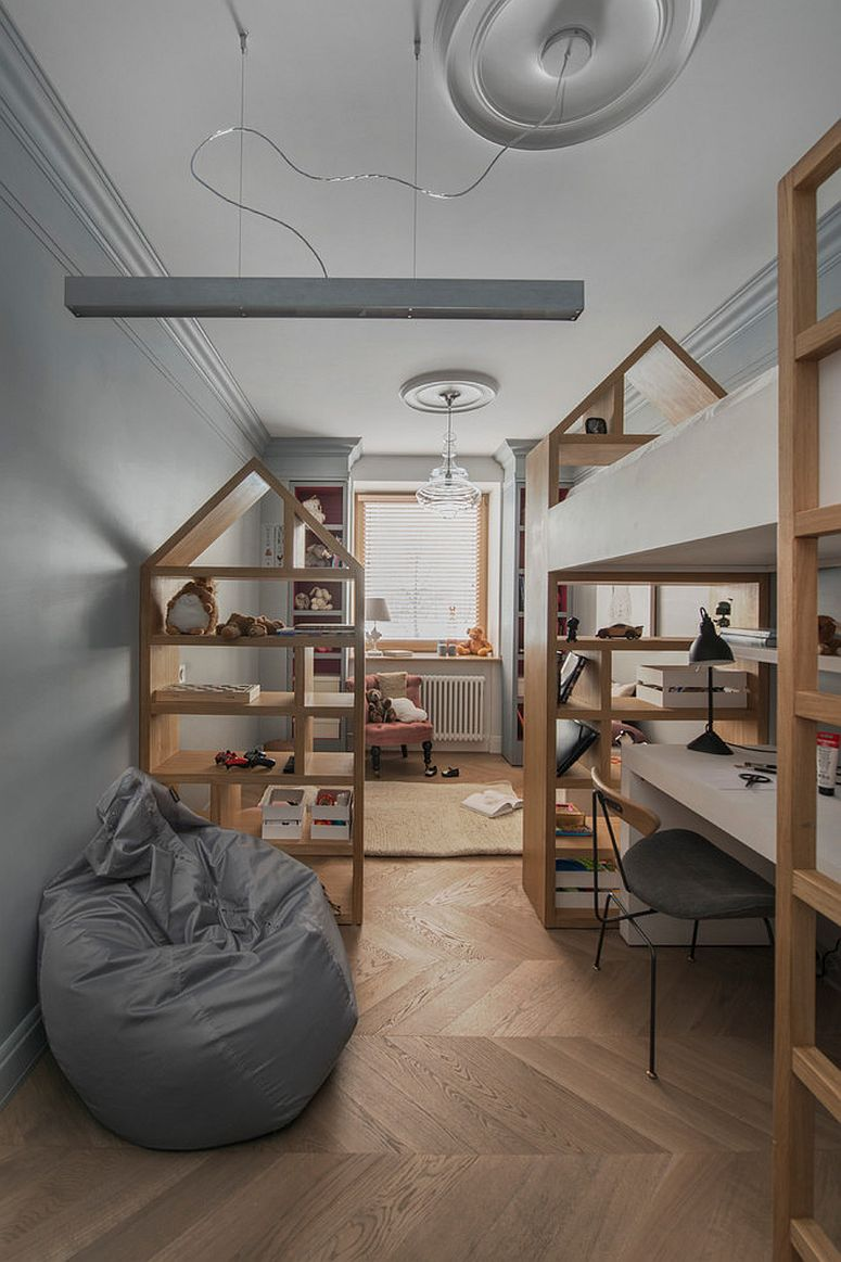 Cool bookshelves and wooden bespoke units create a cool, shared kids' bedroom