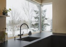 Corner-window-in-the-kitchen-brings-in-ample-natural-light-217x155
