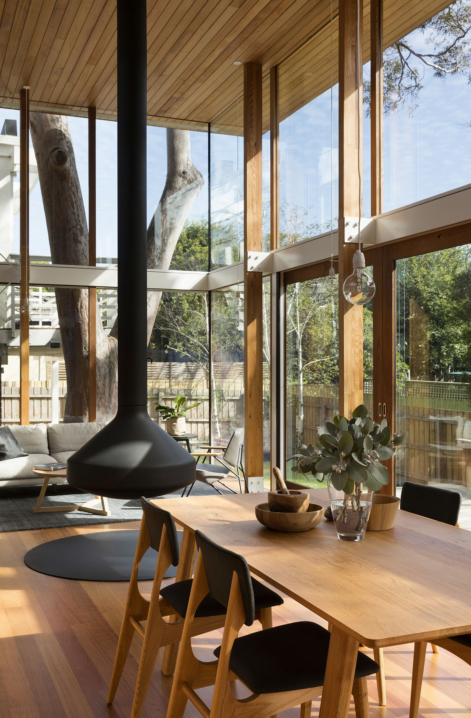 Double height dining room with glass walls