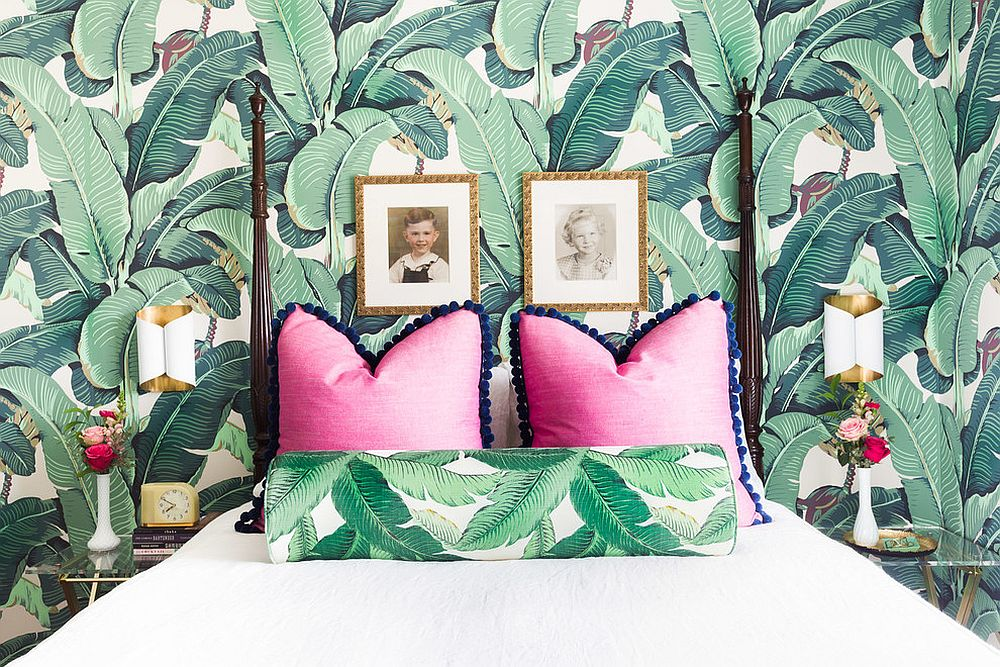 Eclectic bedroom with tropical style and leafy wallpapered backdrop