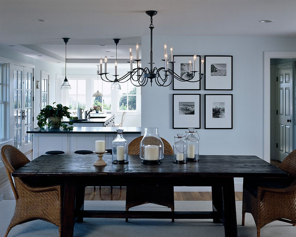 Elegant use of slim, black chandelier in the modern dining room
