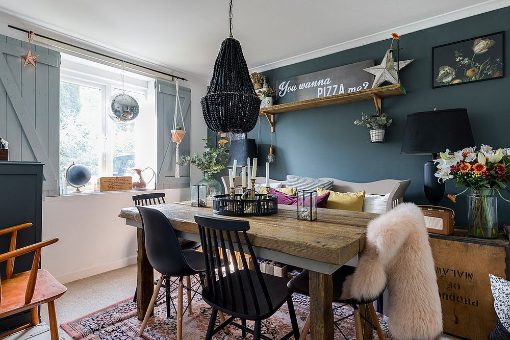 Exquisite use of eclectic design in the dinng room with a dashing black chandelier