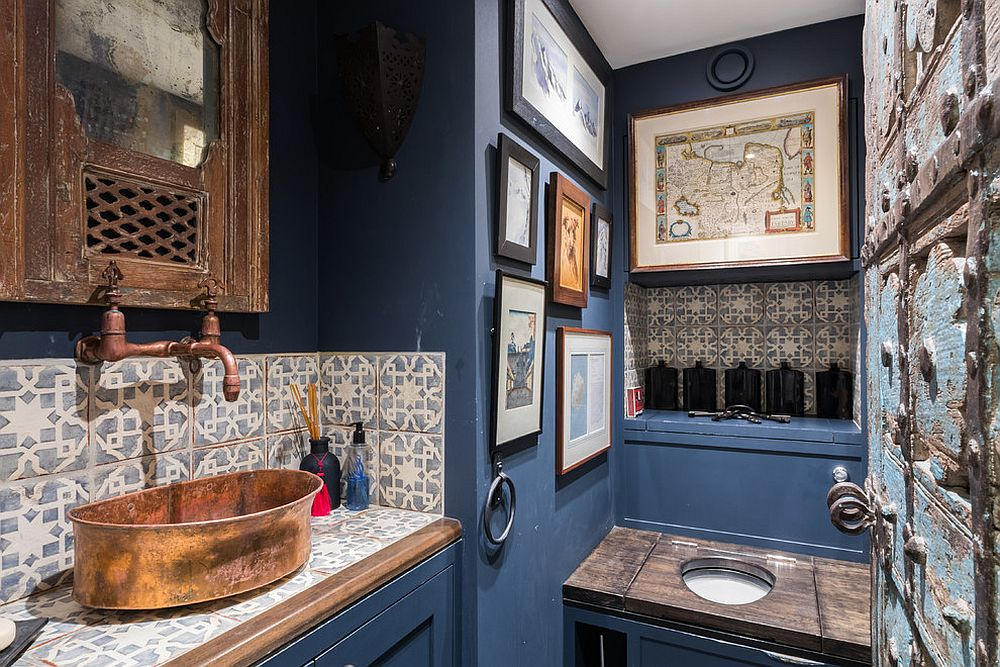 Fabulous Mediterranean powder room in blue with a custom metallic sink and antique shelf doors