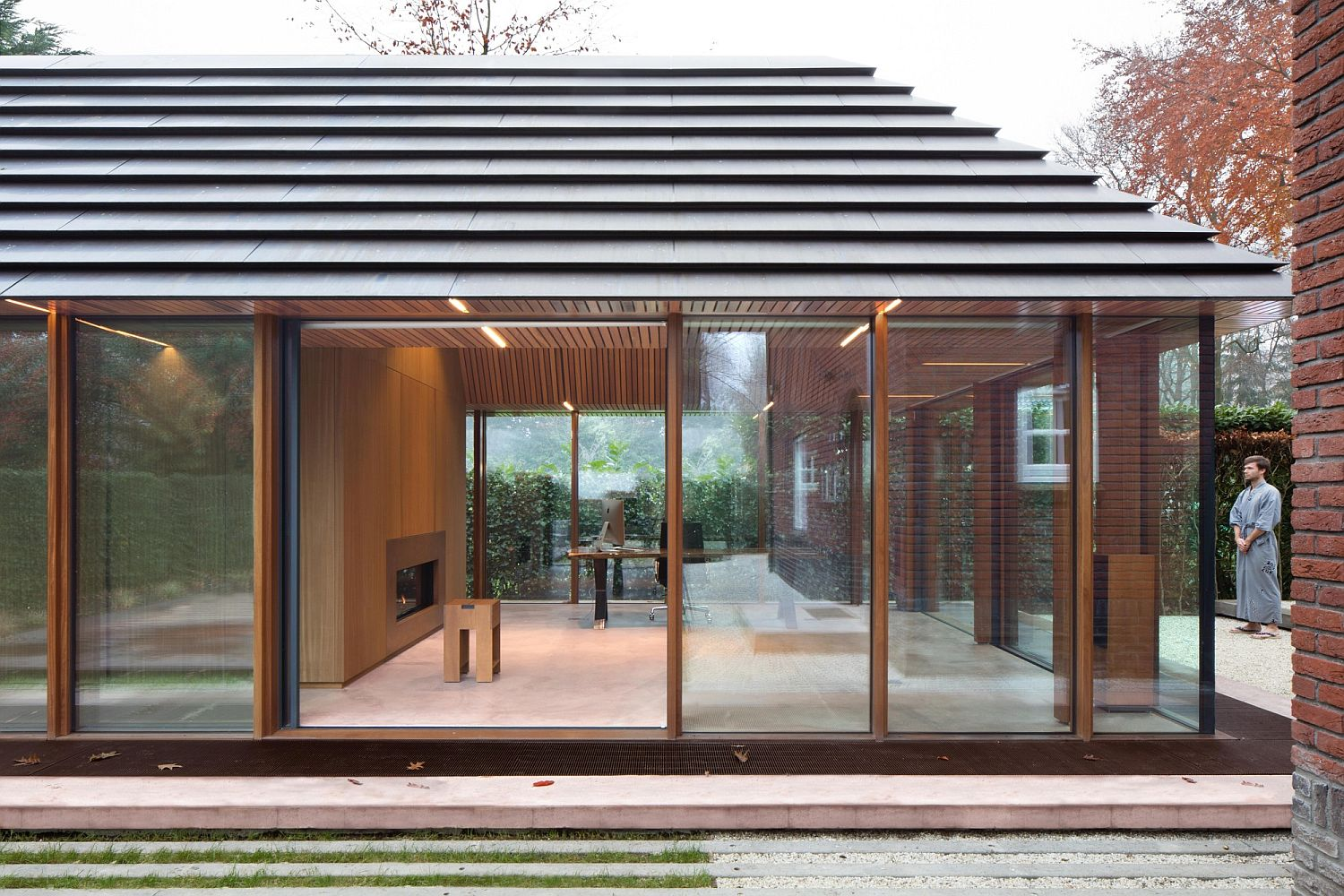 Fabulous copper roof of the office pavilion adds character to the setting