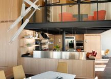 Fabulous-mezzanine-sitting-area-above-the-kitchen-inside-the-modern-condominium-217x155