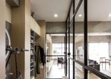 Glass-patitions-and-bicycle-display-inside-the-Japanese-condominium-217x155