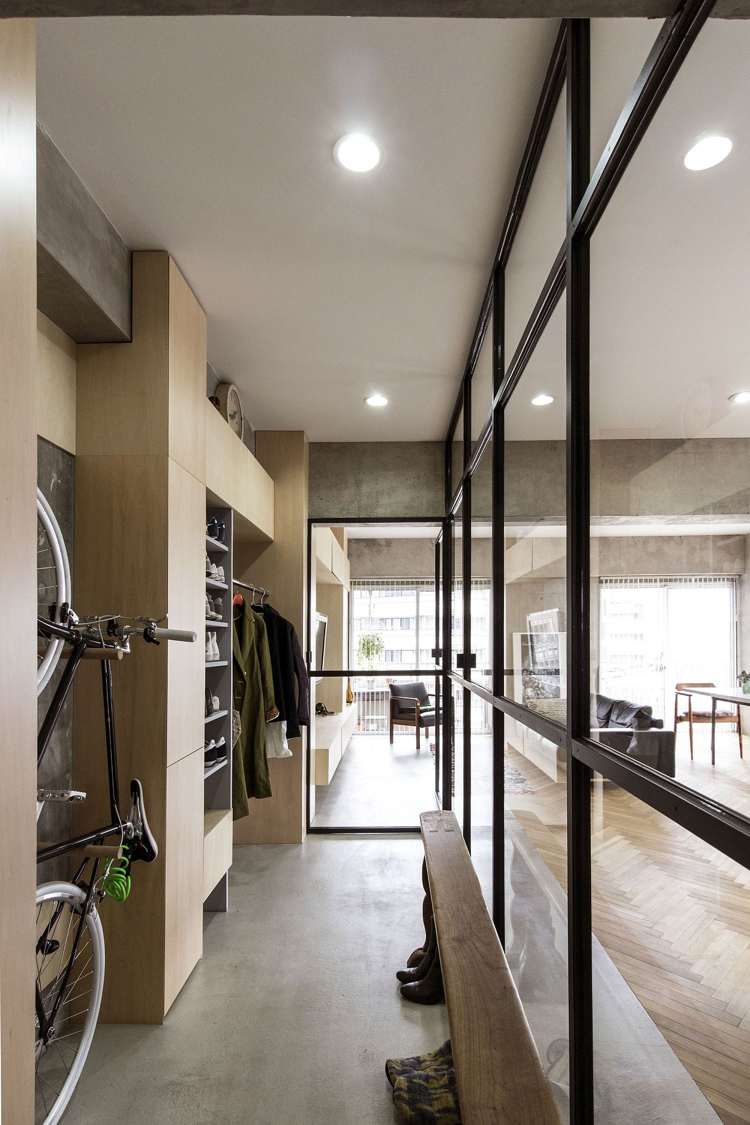 Glass-patitions-and-bicycle-display-inside-the-Japanese-condominium
