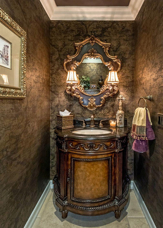 Gold frames add glitter to the Mediterranean powder room