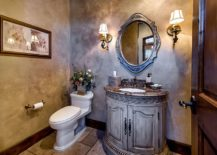 Gorgeous-and-beautifully-lit-Mediterranean-style-powder-room-217x155