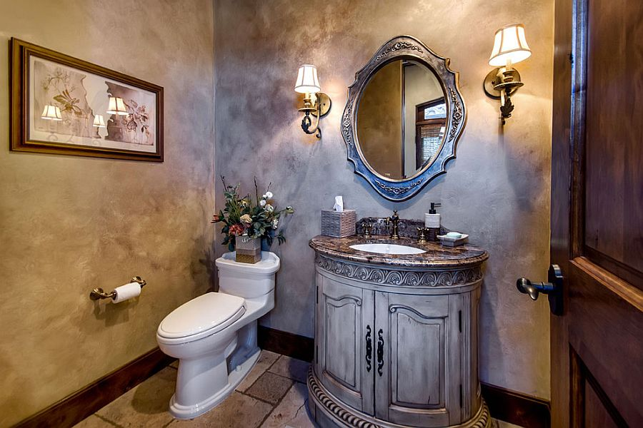 Gorgeous and beautifully lit Mediterranean style powder room