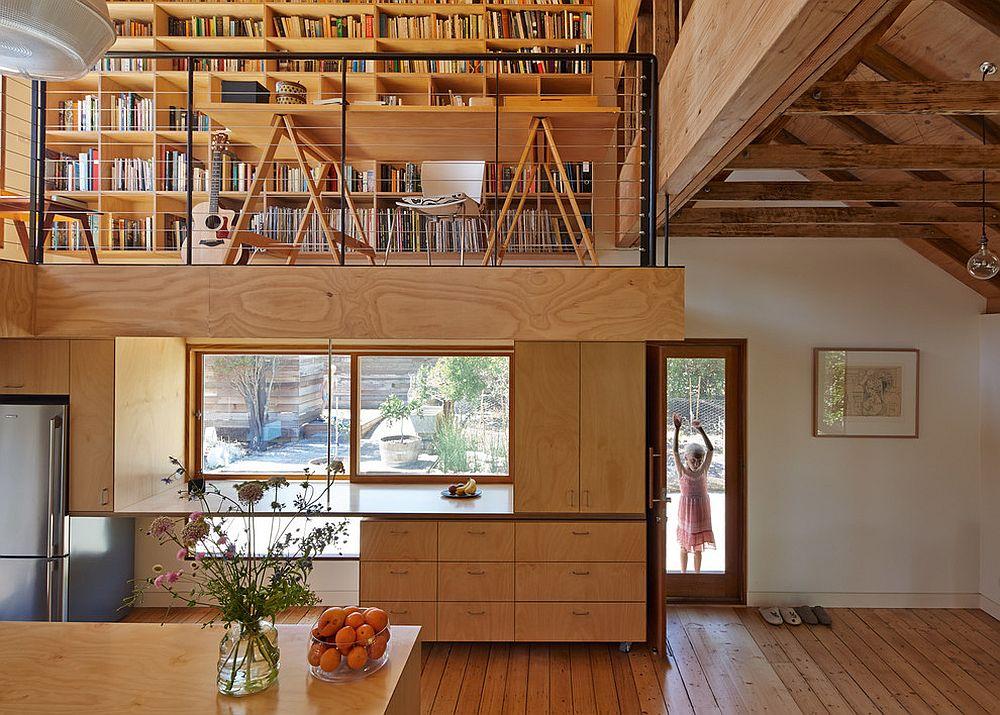Gorgeous farmhouse kitchen in wood with mezzanine level above