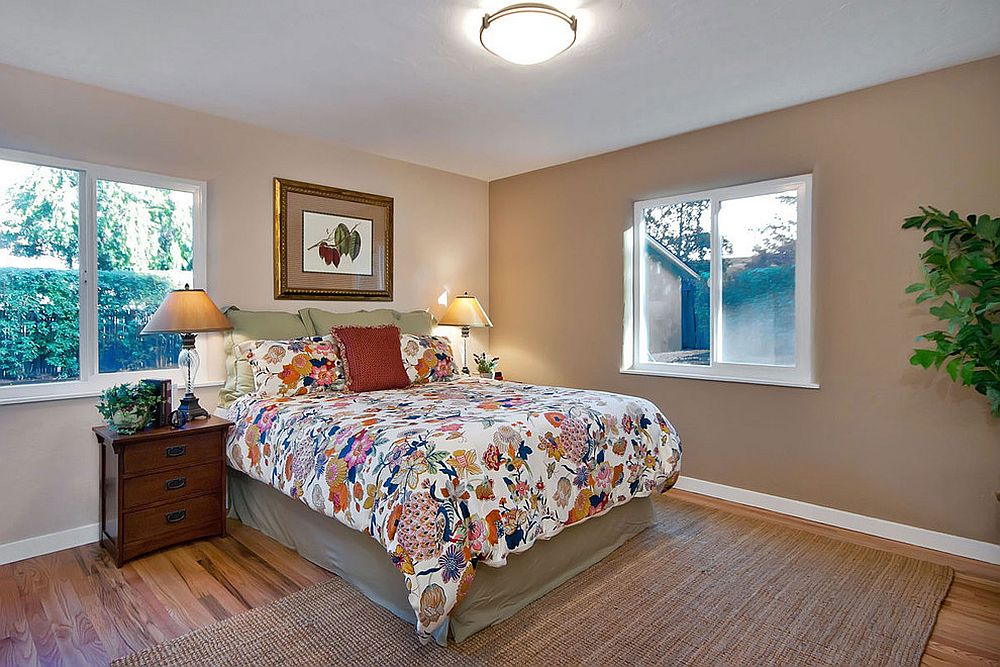 Gorgeous traditional bedroom has a beddding with botanical print