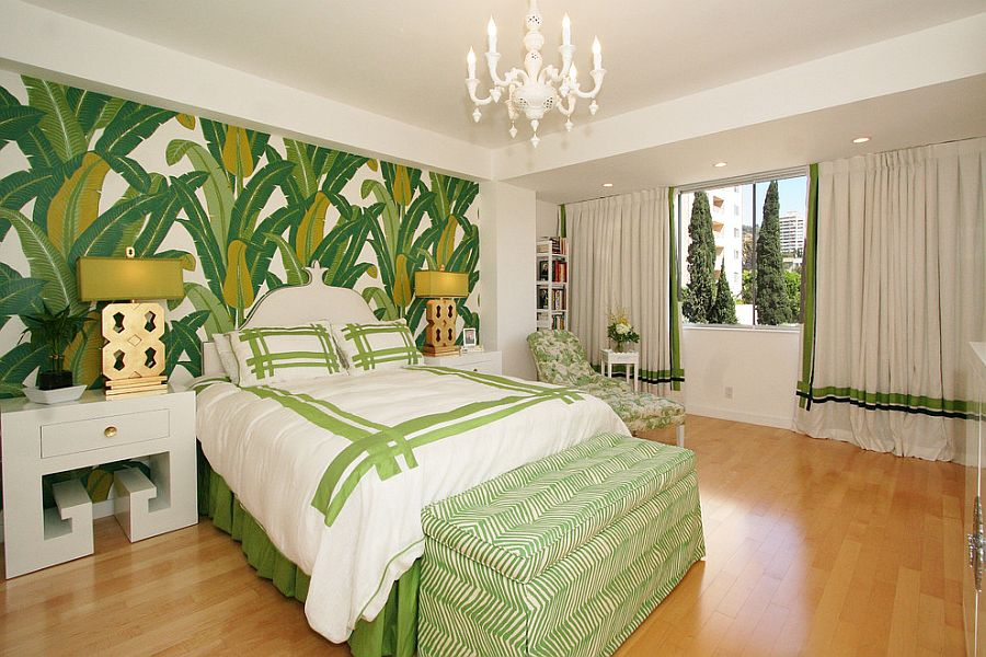 Green and white bedroom with tropical flair