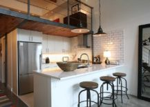 Industrial-style-kitchen-with-a-simple-mezzanine-level-above-that-overlooks-the-living-area-217x155