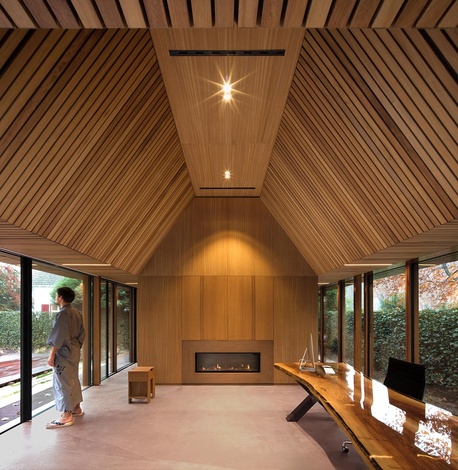 Iroko wood and glass interior of the Tiny Office Pavilion Vught