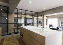 Kitchen-with-polished-counter-and-herringbone-pattern-floor-217x155