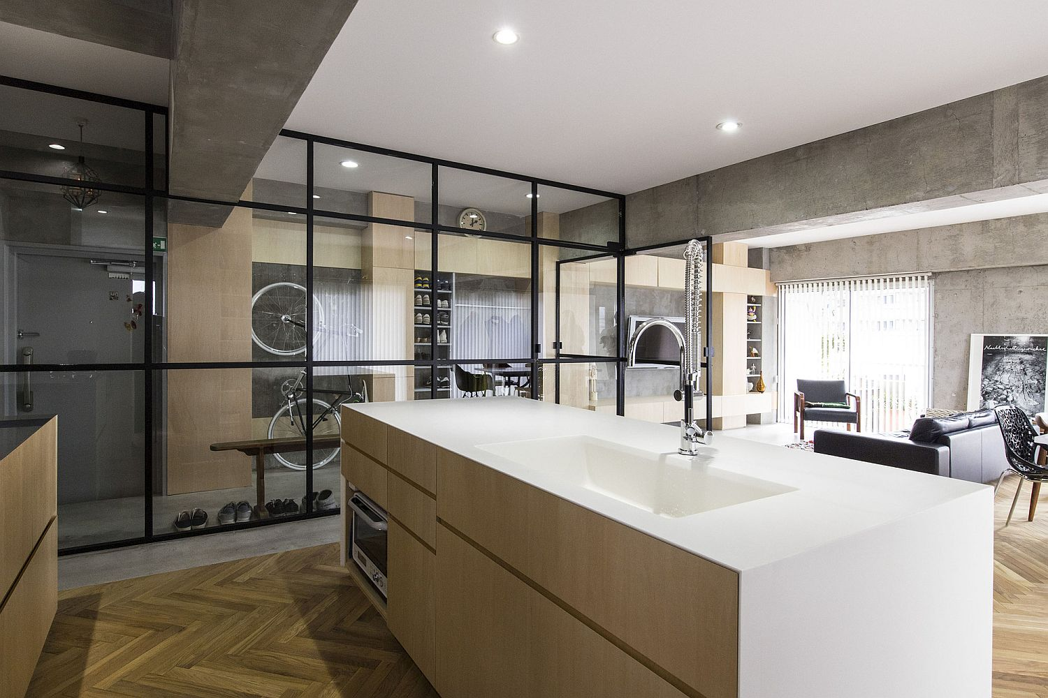 Kitchen-with-polished-counter-and-herringbone-pattern-floor