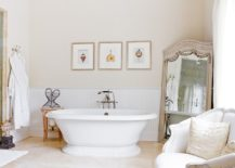 Large-mirror-in-the-corner-of-the-room-with-antique-frame-stands-elegantly-217x155