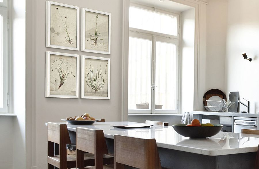 Lovely framed botanicals in the contemporary kitchen replace traditional art