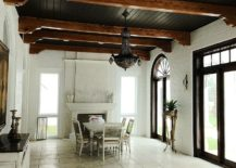Mediterranean-sunroom-in-white-with-a-black-chandelier-217x155