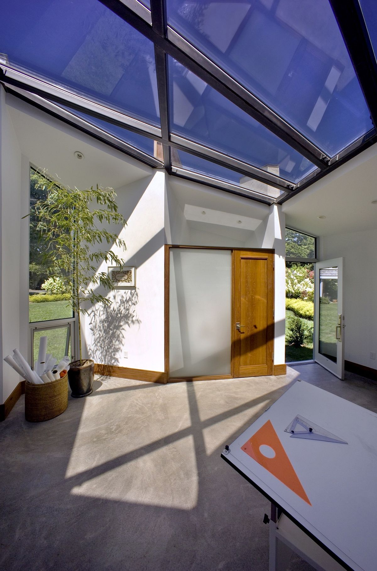 Metal frame and glass roof bring in ample ventilation