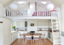 Mezzanine-level-above-the-kitchen-holds-a-cozy-sleeping-space-and-sitting-nook-217x155
