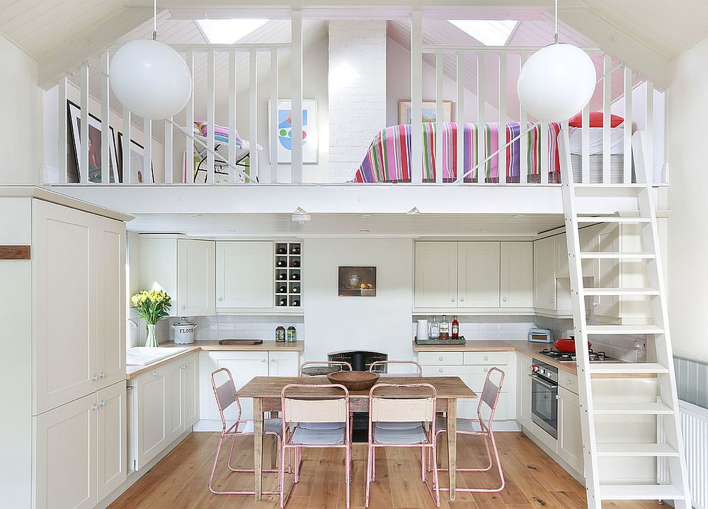 Mezzanine level above the kitchen holds a cozy sleeping space and sitting nook