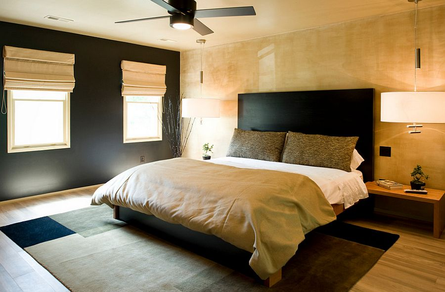 Minimal modern bedroom in black and gold with textured walls