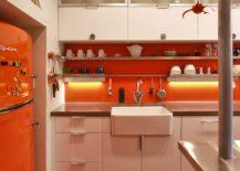Modern-industrial-kitchen-with-brilliant-splashes-of-orange-217x155
